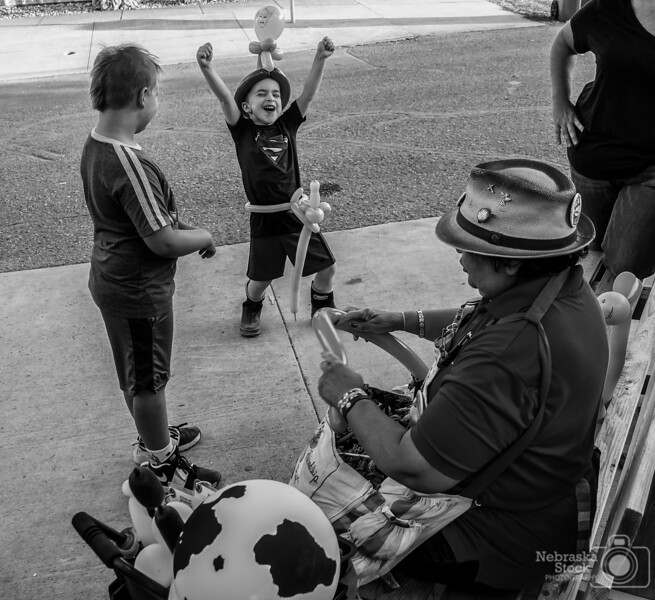 7-27-2018<br /> 208/365<br /> Oh, how a lady tying balloons can make the day of two young boys at the Rock County Fair in Luverne,MN.<br /> Photo taken with a Sony RX100M4<br /> ISO 250<br /> 1/200th at F2.8<br /> (118827)
