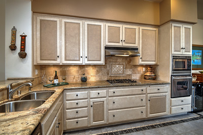 KITCHEN WITH GRANITE COUNTERS AND GAS RANGE