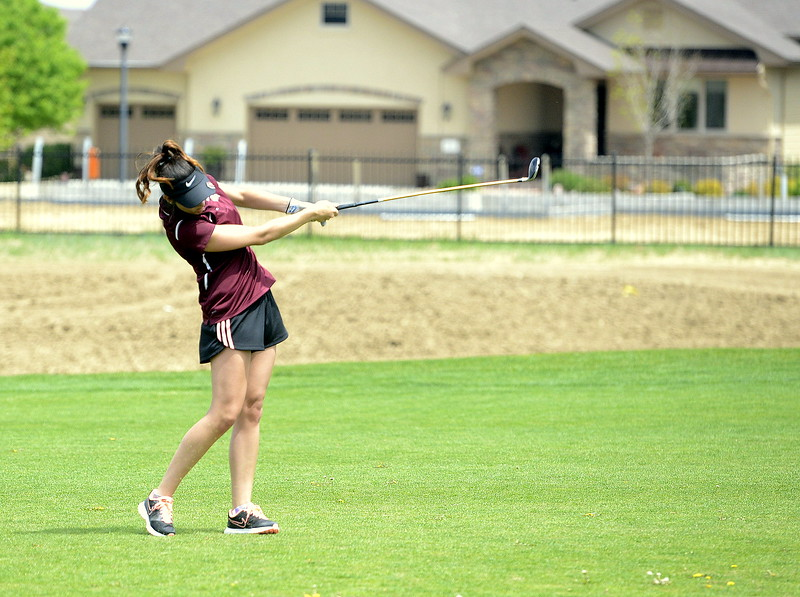 Berthoud's Shannyn McEntee follows through on an approach shot during Monday's 3A Region 3 golf tournament at Highland Meadows golf course in Windsor. (Photo by Mike Brohard/Loveland Reporter-Herald)