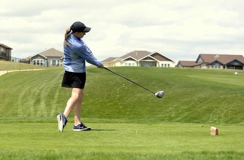 Elisabeth Perl of Resurrection Christian hits a drive during Monday's 3A Region 3 golf tournament at Highland Medows Golf Course. Perl shot a 92 to qualify for state.  (Photo by Mike Brohard/Loveland Reporter-Herald)