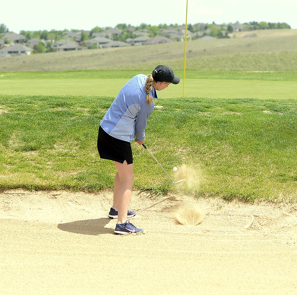 Resurrection Christian's Elisabeth Perl chips out a green-side bunker during Monday's 3A Region 3 golf tourmament at Highland Meadows golf course in Windsor. She finished with a 92, qualifying for the state tournament.  (Photo by Mike Brohard/Loveland Reporter-Herald)