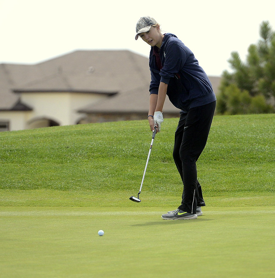 Kyra McDonald of Berthoud watches the path of her putt during Monday's 3A Region 3 golf tournament at Highland Meadows Golf Course in Windsor. McDonald shot an 88 to qualify for the state tournament.