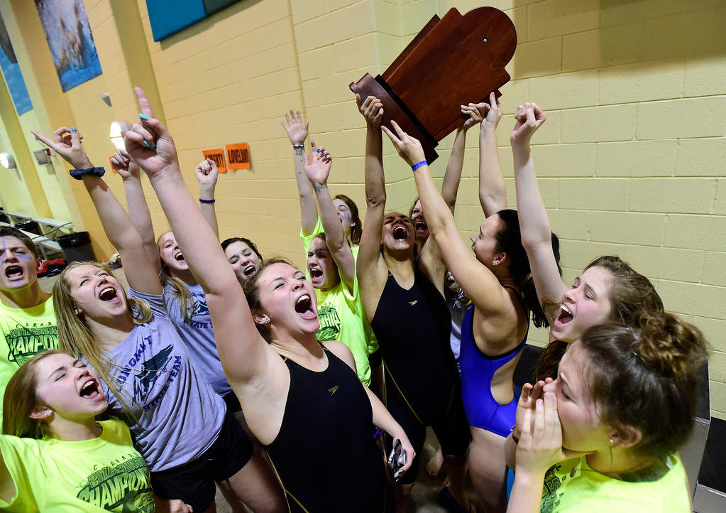 . The Longmont High School swimming team celebrates winning the CHSAA 3A Swimming Championships on Friday at the Veterans Aquatic Center in Northglenn. More photos: BoCoPreps.com Jeremy Papasso/ Staff Photographer 02/09/2018