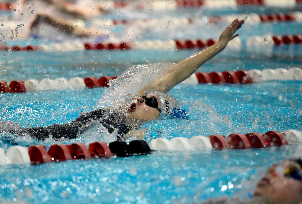 . Longmont High School\'s Emma Svendsen swims in the 100-yard backstroke final during the CHSAA 3A Swimming Championships on Friday at the Veterans Aquatic Center in Northglenn. More photos: BoCoPreps.com Jeremy Papasso/ Staff Photographer 02/09/2018