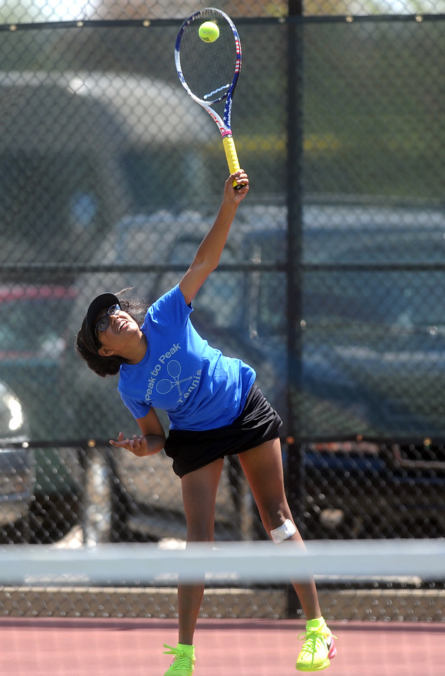 Peak to Peak's Trisha Somasundaram serves during the 3A semifinals match on Thursday at the Centennial Courts in Greeley, Colo.(Joshua Polson/The Greeley Tribune)