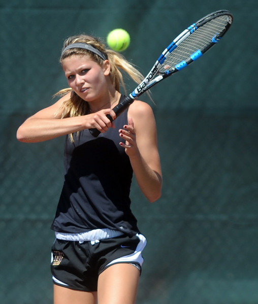 Holy Family's Paige Giltner plays in the 3A semifinals match on Thursday at the Centennial Courts in Greeley, Colo.(Joshua Polson/The Greeley Tribune)