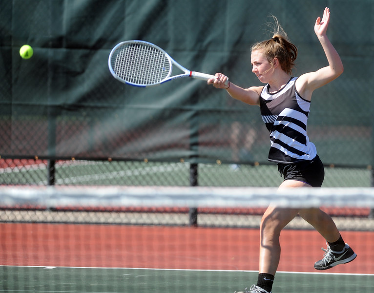 Mead's Emma Drouhard winds up to swing the racquet as she plays in the 3A semifinals match on Thursday at the Centennial Courts in Greeley, Colo.(Joshua Polson/The Greeley Tribune)