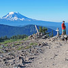 """Bill on the Pacific Crest Trail-Mt. Adams.<br>Goat Rocks—PCTWA-SU 21aug2016<br>https://connect.garmin.com/modern/activity/1315014362<br>As PNW hikes go, I still feel like a rookie. My first """"official"""" hike was Sept 2015. Since then, I've added another 17-hikes (incl snowshoes) and even a summit of Mount Rainier. If I do the OCD math right, that's about 146.0-miles/8.1-miles per hike (day). That said, this morning's hike ranks in the top-3 of my favs and most inspirational. Hike #2/sep2015-I got so close to the Mt Rainier glacier and felt so strong on the Burroughs #3 hike that I began to contemplate actually going for the summit of Rainier. Hike #4/oct2015-Watched the sunrise come up on Rainier from Fremont Lookout, combined with listening to Ryan's tales of conquering the summit, truly inspired and convinced me that I too could summit Rainier. Then this morning…it was only about 1.5mi to the intersection of the Pacific Coast Trail, but as I watched the sun come up over the Goat Rocks valley below Old Snowy Mt and gazed upon Mt Adams and Mt St Helens, I had an epiphany…I must summit another mountain…better yet, I think the Pacific Coast Trail is calling my name. But I'm getting ahead of myself…first up, this weekends hikes (#19-20) at Goat Rocks Wilderness in the Snoqualmie/Gifford Pinchot National Forest on the crest of the Cascade Range. <br><br>WA-goat_rocks-21aug2016_I9129"""
