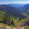 """Goat Rocks—Goat Lake Hike/CampWA-20aug2016. <br>https://connect.garmin.com/modern/activity/1315013895<br>Goat Rocks Wilderness in the Snoqualmie/Gifford Pinchot National Forest on the crest of the Cascade Range. <br>Hot Hike. One of the hottest days of 2016. Bill and I embarked on Snowgrass Trail #96 and reached camp a little over 5-miles later. Did a quick set-up of tents and then traversed another 2+miles on the Lily Basin Trail to Goat Lake. The aqua-marine waters were tempting in the afternoon sun, but we elected to only cool our heels and not take the deep dive into the glacier waters, like several hikers around us. The vista views from trail #86 were incredible. I felt like I needed to keep my cameras on panoramic mode. Crossing waterfalls, looking up at mountain goats on the ledges of Hawkeye Point, gazing across the lush green/flowers blooming valley at Mount Adams. 10-miles/2500' elevation gain of hike in a photographers paradise. Back at base camp, we ate dinner around the campfire and talked world affairs with our Russian neighbors. A very memorable, very cool all-around experience. I awoke around 2am thinking someone was shining a light into my tent. Poked my head out and was greeted by a shockingly bright full moon and spectacularly clear star-field that reminded me of the night I summited Rainier. Little did I know, my fav take-away from this hike/campout (photography """"magic moment"""") was about to happen at sunrise on the Pacific Coast Trail…<br>Mt Adams<br><br>WA-goat_rocks-20aug2016i8863"""