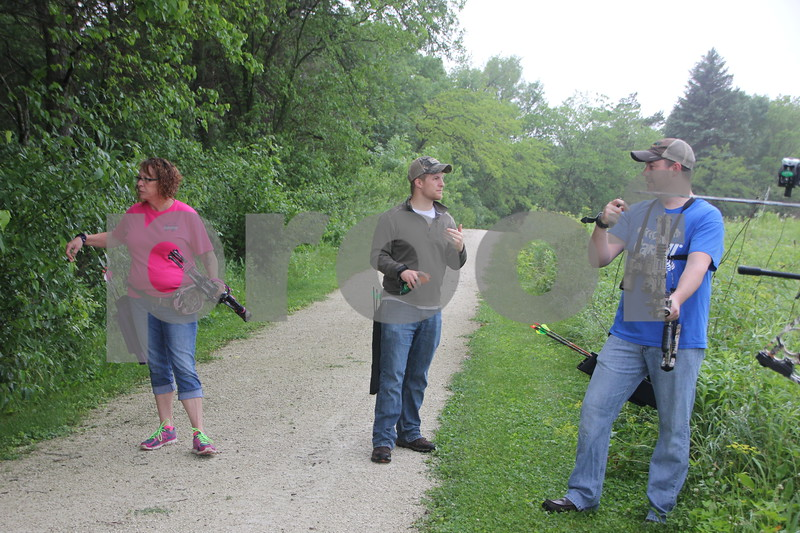 Left to right are : Tracy Reed, Jacob Asche, and Dave Schott who were just some of the  participants at the 3-D Archery Shoot on Saturday, June 13, 2015 held at Kennedy Park. The event will end on Sunday, June 14, 2015.