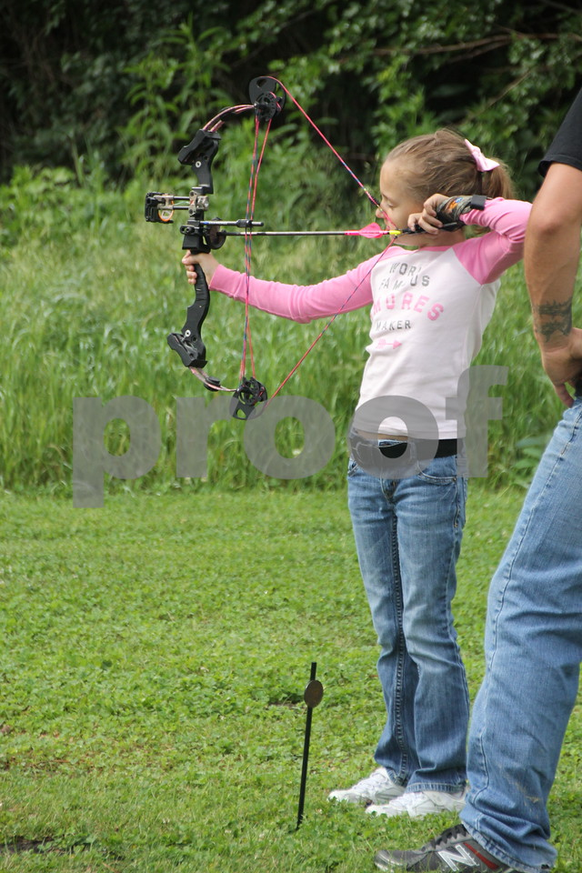 Here Tessa Lyon takes a turn at the 3-D archery  Shoot on Saturday, June 13, 2015 held  at Kennedy Park. Tessa, 7 years old,  is  among  one of the youngest  taking part in the event on Saturday. The event ends Sunday, June 14, 2015.