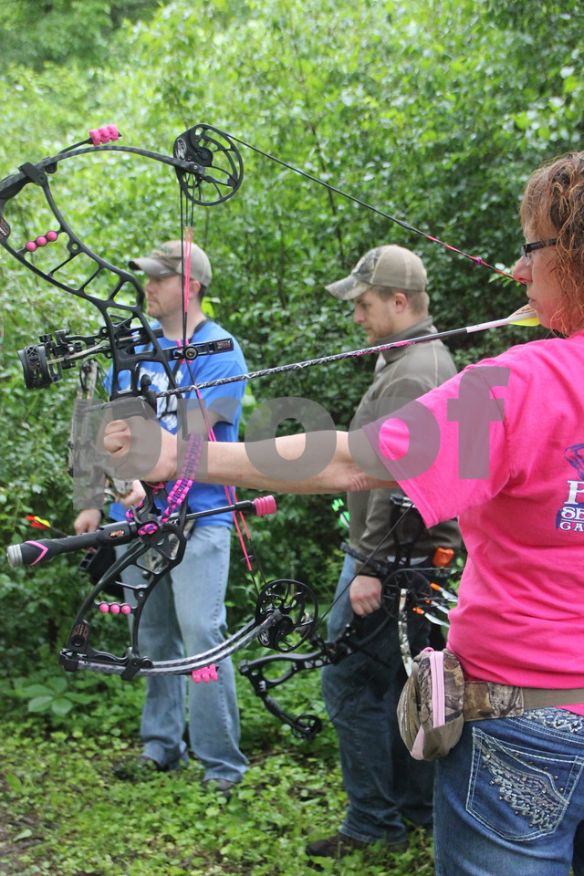 Right to Left are: Tracy Reed (shooting), Jacob Asche, and Dave Schott, participants in the 3-D Archery Shoot that took place at Kennedy Park on Saturday, June 13, 2015 and ends Sunday, June 14, 2015.
