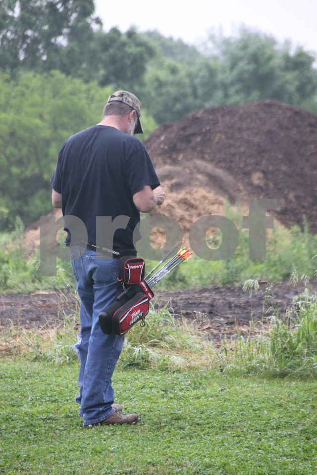 The 3-D Archery Shoot was held on Saturday, June 13, 2015 at Kennedy Park and will finish up on Sunday, June 14,2015. Steve McNeil records his score after shooting at the target at one of many stations set up at this event.