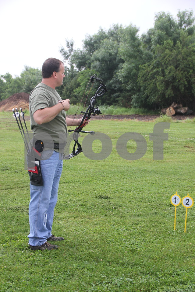 Jeff Waldera pauses after taking a shot at a 3-D target at the 3-D Archery Shoot  event held on Saturday, June 13, 2015 at Kennedy Park which goes till Sunday, June 14, 2015.
