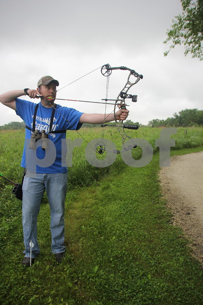Dave Schott concentrates in preparation to take a shot at the target at one of  stations at the 3-D Archery  Shoot on Saturday, June 13, 2015 held at Kennedy Park. Sunday, June 14, 2015 will be the events last day this go round.