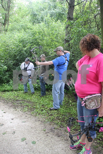 Right to Left are: Tracy Reed, Dave Schott (shooting), Jacob Asche, and Roger Willey. They took part in the 3-D Archery Shoot held on Saturday, June 13, 2015 and ending Sunday, June 14, 2015, at Kennedy Park.