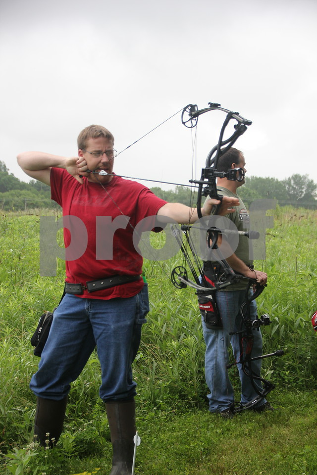 Seen here is (left to right): Josh Filmer and Jeff Waldera. They were taking part in the 3-D Archery Shoot  held at Kennedy Park on Saturday, June 13, 2015 which ends Sunday, June 14, 2015.