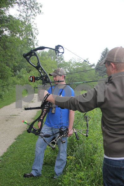 Right to Left is : Jacob Asche (shooting) and Dave Schott who were some of the participants in the 3-D Archery Shoot that took place at Kennedy Park on Saturday, June 13, 2015. The event will end on Sunday, June 14, 2015.