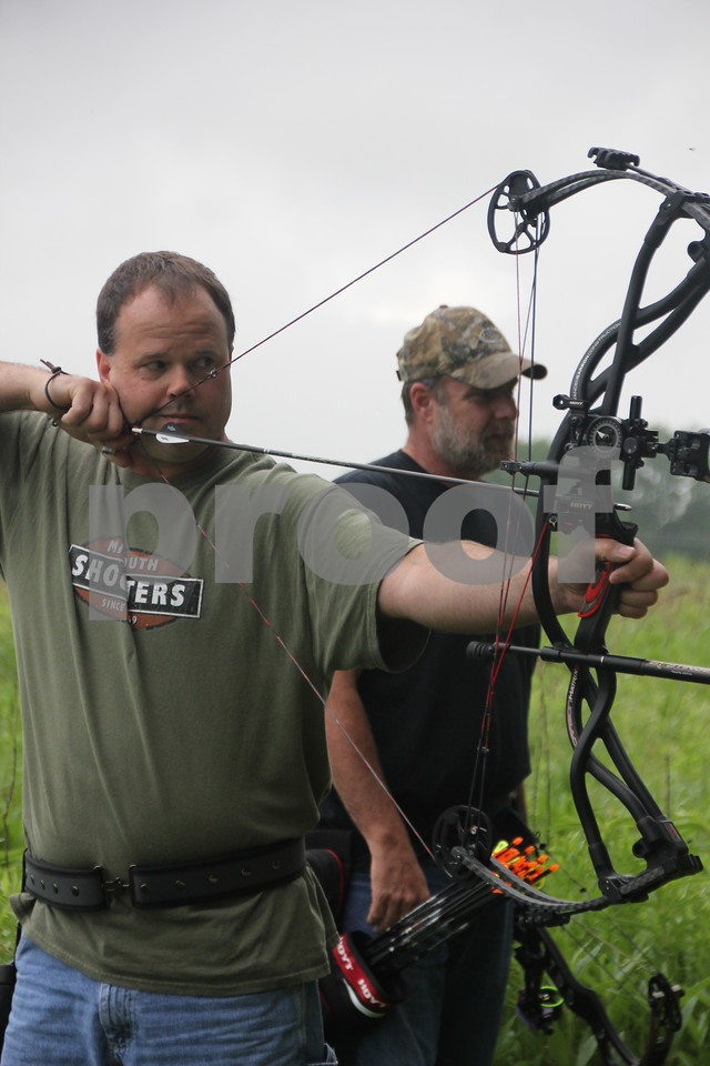 Jeff Waldera (left) takes his shot at the 3-D Archery Shoot on Saturday, June 13, 2015 held at Kennedy Park, as Steve McNeil (right) waits for his turn. The event ends Sunday, June 14, 2015.