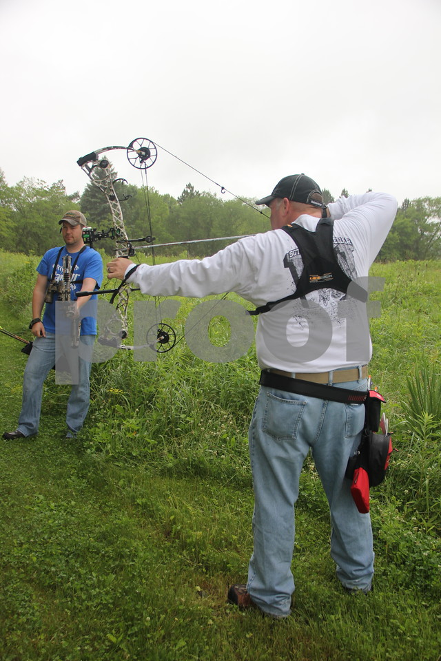 Saturday, June 13, 2015 the 3-D Archery Shoot took place at Kennedy Park and will end on Sunday, June 14, 2015.  Dave Schott (left) looks on as Roger Willey is seen taking his shot at one of many  target stations set up for this event .