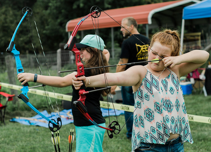 Micheala Doran, 10, shoots during the 3D bow hunting event that was held at Hollis Hills Farm, co-sponsored by Boston Bow Hunters, on Saturday, July 22, 2017. SENTINEL & ENTERPRISE / Ashley Green