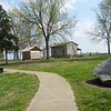 General Clark's cabin on the right and slave quarters at the left rear of the Clark larger cabin.