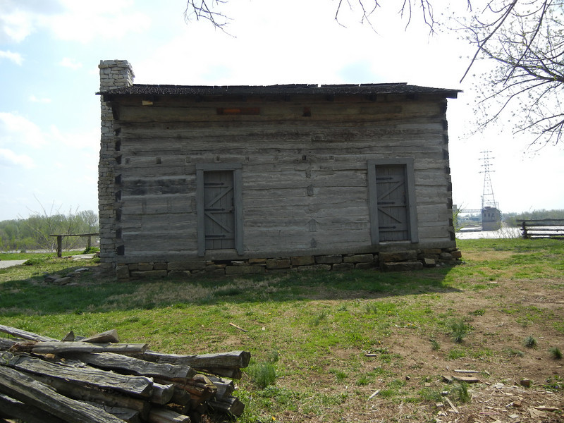 Rear of the General Clark replica cabin. Typical of the era, relatively wealthy homeowner's homes could be 12 feet by 15 feet. Often one room homes but situated on thousands of acres of land.  This particular cabin was located with a very scenic view of the Ohio River and today's town of Louisville, Kentucky on the distance shore. General Clark was never wealthy and was never paid all of his military pension.  He died living on his sister's and brother-in-laws plantation east of Louisville.