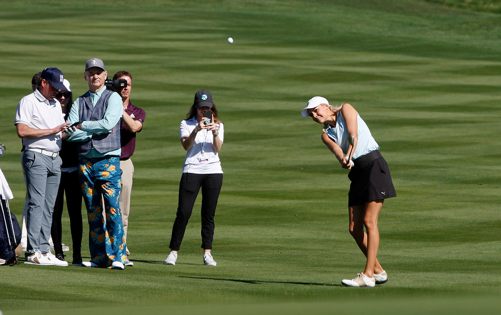 . Bill Murray watches as actress Kelly Rohrbach hits during the 3M Celebrity Shoot-Out at the Pebble Beach Golf Links in Pebble Beach on Wednesday, Feb. 7, 2018.   (Vern Fisher - Monterey Herald)