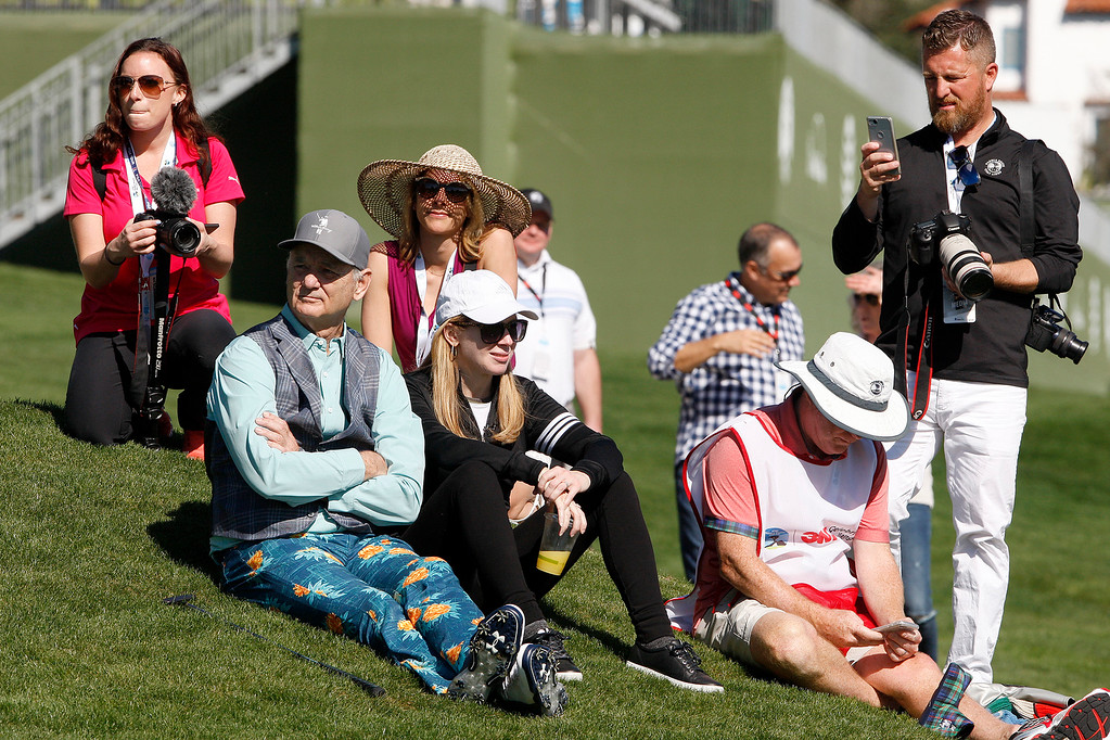 . Bill Murray takes a break with the crowd during the 3M Celebrity Shoot-Out at the Pebble Beach Golf Links in Pebble Beach on Wednesday, Feb. 7, 2018.   (Vern Fisher - Monterey Herald)