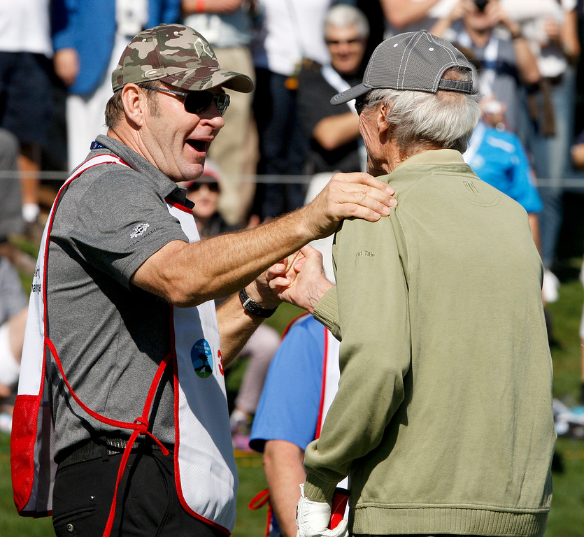 . Clint Eastwood gets congratulations from his caddy former PGA player Nick Faldo during the 3M Celebrity Shoot-Out at the Pebble Beach Golf Links in Pebble Beach on Wednesday, Feb. 7, 2018.   (Vern Fisher - Monterey Herald)