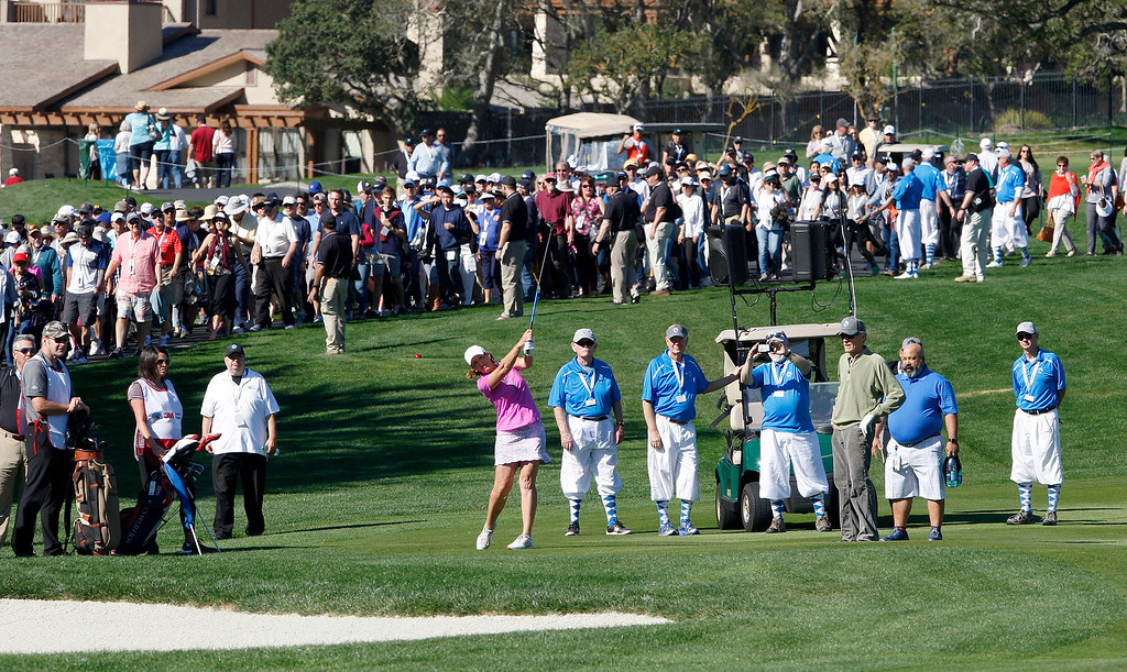 . Juli Inkster (pink) hits her second shot on the second hole him during the 3M Celebrity Shoot-Out at the Pebble Beach Golf Links in Pebble Beach on Wednesday, Feb. 7, 2018.   (Vern Fisher - Monterey Herald)