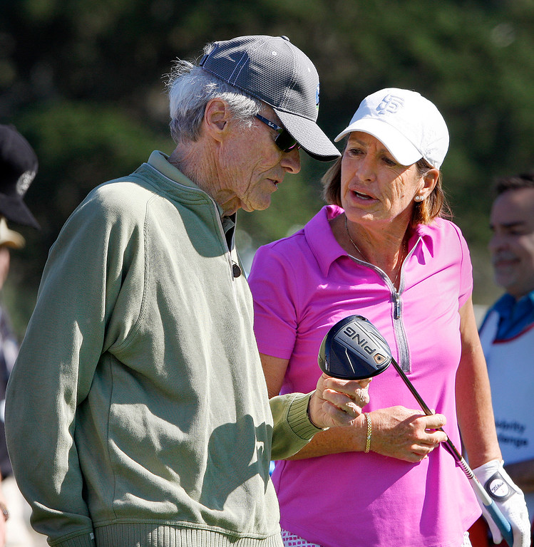 . Clint Eastwood gets some advice from Juli Inkster during the 3M Celebrity Shoot-Out at the Pebble Beach Golf Links in Pebble Beach on Wednesday, Feb. 7, 2018.   (Vern Fisher - Monterey Herald)