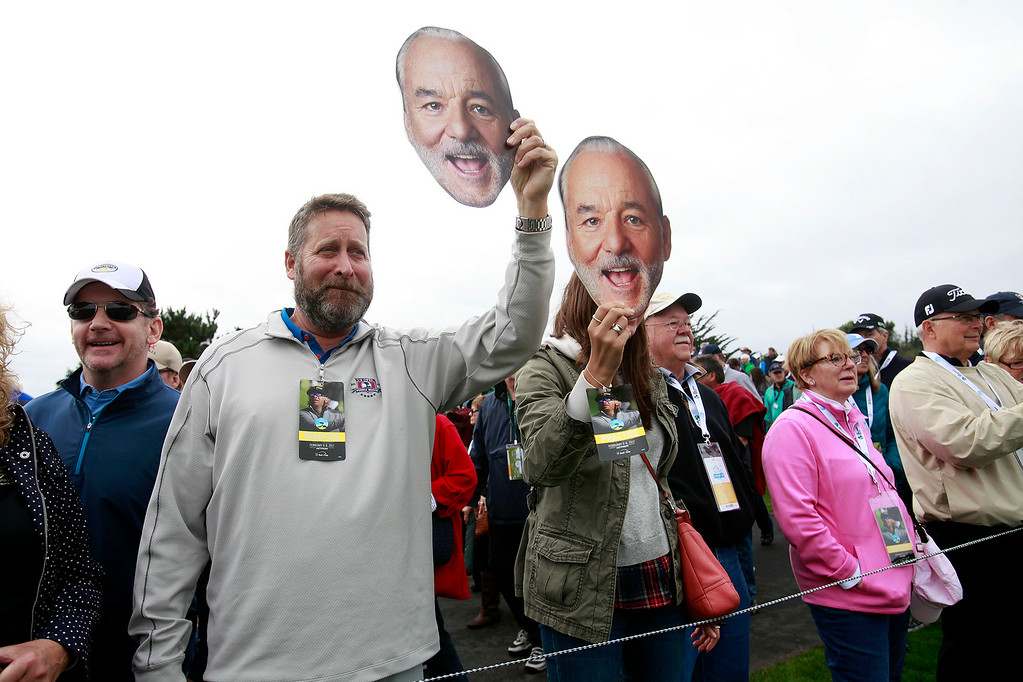 . Fans hold Bill Murray masks during the 3M Celebrity Challenge at the Pebble Beach Golf Links on Wednesday, Feb. 8, 2017 during the AT&T Pebble Beach Pro Am.  (Vern Fisher - Monterey Herald)
