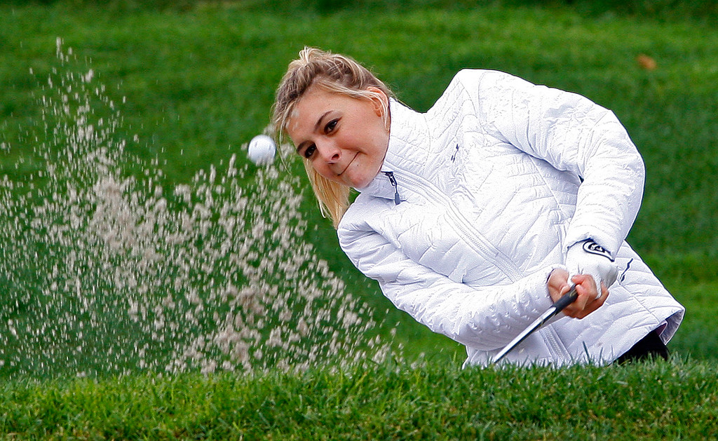 . Model/actor Kelly Rohrbach hits from a bunker on the 3rd hole during the 3M Celebrity Challenge at the Pebble Beach Golf Links on Wednesday, Feb. 8, 2017 during the AT&T Pebble Beach Pro Am.  (Vern Fisher - Monterey Herald)