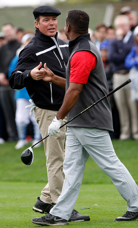 . Clay Walker and Alfonso Ribeiro celebrate a putt during the 3M Celebrity Challenge at the Pebble Beach Golf Links on Wednesday, Feb. 8, 2017 during the AT&T Pebble Beach Pro Am.  (Vern Fisher - Monterey Herald)