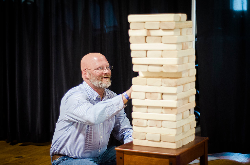 . Kevin Wiggs plays a game of giant jenga during the third annual Oktoburgfest at the Fitchburg Senior Center on Saturday, October 14, 2017. SENTINEL & ENTERPRISE / Ashley Green