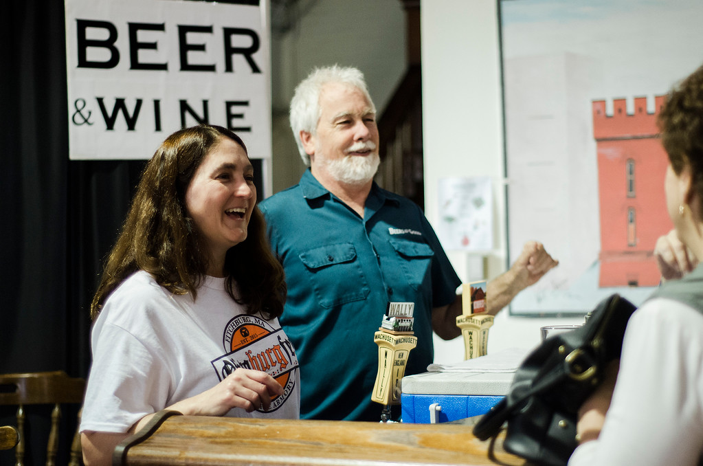 . Amy LeBlanc and Dave Strebb  serve cold beer from Wachusett Brewery during the third annual Oktoburgfest at the Fitchburg Senior Center on Saturday, October 14, 2017. SENTINEL & ENTERPRISE / Ashley Green