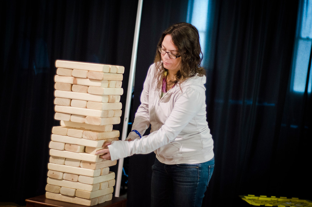 . Kelly Johnson plays a game of giant jenga during the third annual Oktoburgfest at the Fitchburg Senior Center on Saturday, October 14, 2017. SENTINEL & ENTERPRISE / Ashley Green