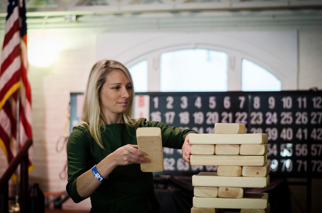 . Sam Squailia plays a game of giant jenga during the third annual Oktoburgfest at the Fitchburg Senior Center on Saturday, October 14, 2017. SENTINEL & ENTERPRISE / Ashley Green