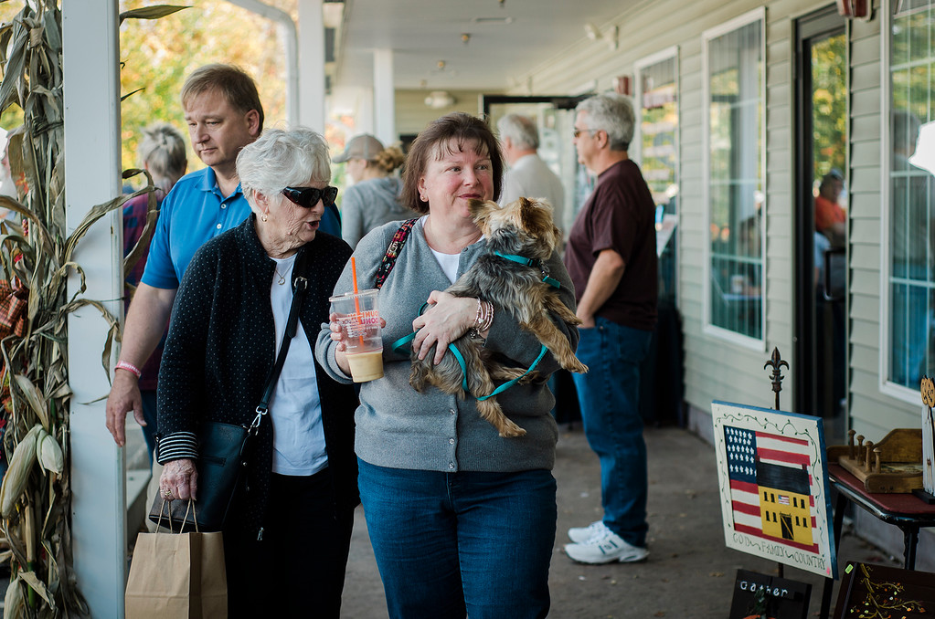 . Sandy Nelson, along with Christine Sadowski and Pookey, enjoy the 3rd annual Westminster Cracker Festival on Saturday, October 21, 2017. SENTINEL & ENTERPRISE / Ashley Green
