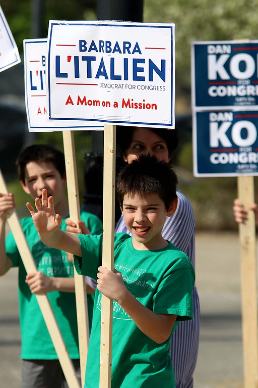 . The debate for the Third District was held at Fitchburg State University\'s Conlon Fine Arts building on Wednesday night in Fitchburg. River Reilly, 12, from Townsend holds a sign for Barbara L\'Italien outside just before the debate started. SENTINEL & ENTERPRISE/JOHN LOVE