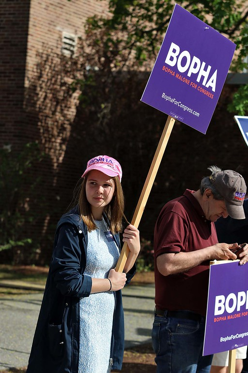 . The debate for the Third District was held at Fitchburg State University\'s Conlon Fine Arts building on Wednesday night in Fitchburg. Cecilia Cronin holds a sign for Bopha Malone outside just before the debate started. SENTINEL & ENTERPRISE/JOHN LOVE
