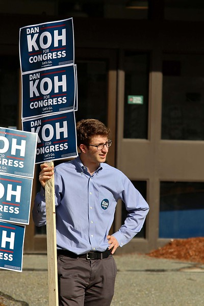 The debate for the Third District was held at Fitchburg State University's Conlon Fine Arts building on Wednesday night in Fitchburg. Justin Curtis, 20, from Boxford holds a sign for Dan Koh outside just before the debate started. SENTINEL & ENTERPRISE/JOHN LOVE