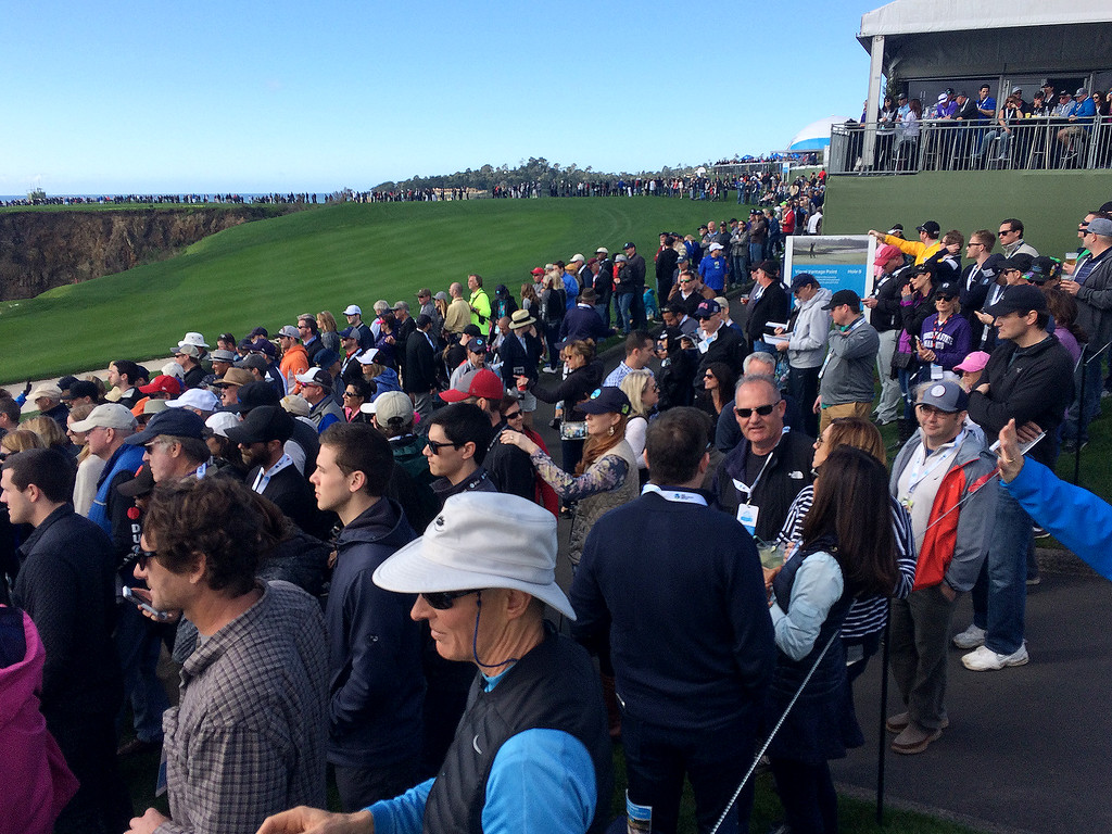 . Large galleries around the 8th hole at the Pebble Beach Golf Links during the third round of the AT&T Pebble Beach Pro Am on Saturday, Feb. 11, 2017.   (Vern Fisher - Monterey Herald)