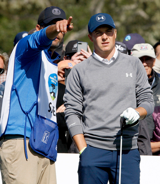 . Jordan Spieth and caddy discuss his tee shot on the 6th hole at the Pebble Beach Golf Links during the third round of the AT&T Pebble Beach Pro Am on Saturday, Feb. 11, 2017.   (Vern Fisher - Monterey Herald)