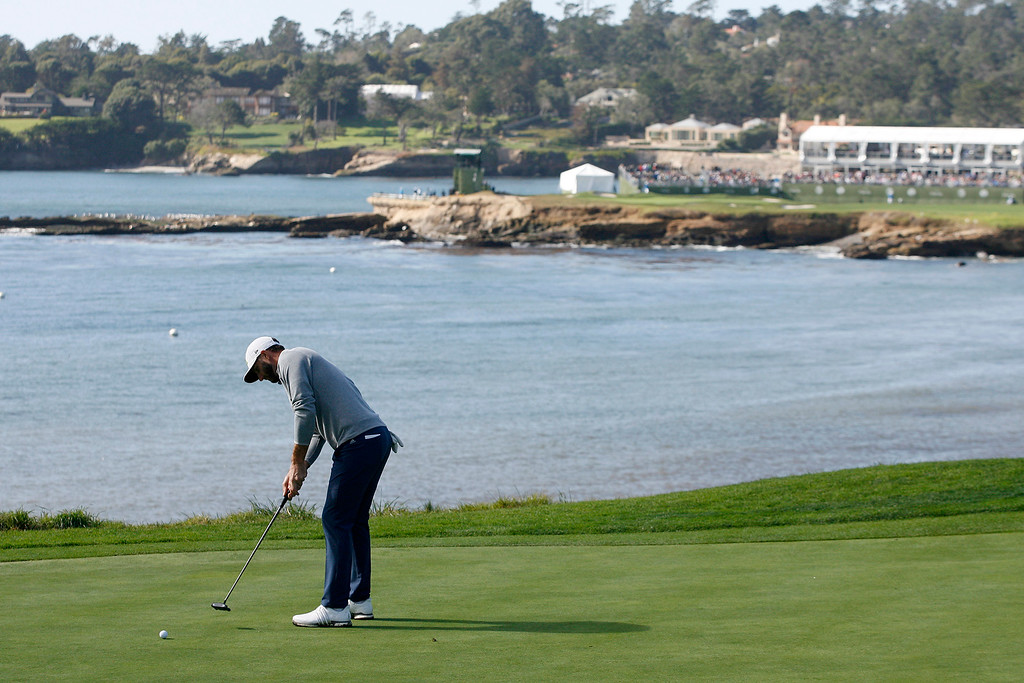. Dustin Johnson putts on the 5th hole at the Pebble Beach Golf Links during the third round of the AT&T Pebble Beach Pro Am on Saturday, Feb. 11, 2017.   (Vern Fisher - Monterey Herald)