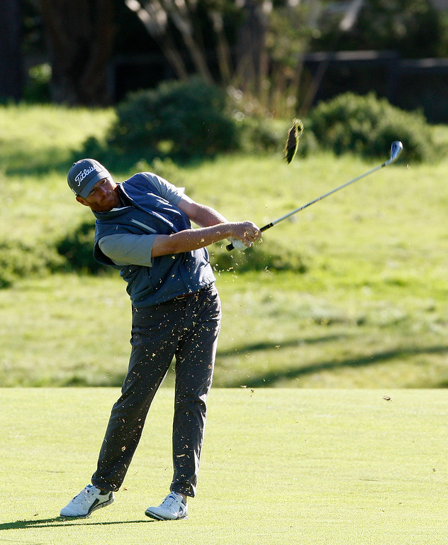. Derek Fathauer hits his second shot on the first hole at Monterey Peninsula Country Club during the third round of the AT&T Pebble Beach Pro Am on Saturday, Feb. 11, 2017.   (Vern Fisher - Monterey Herald)