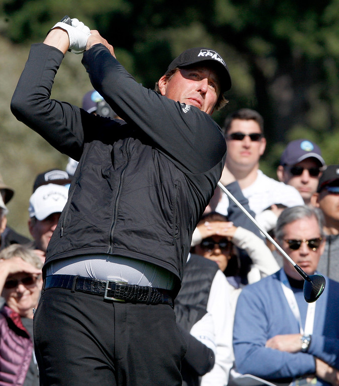 . Phil Mickelson watches his tee shot from the 6th hole at the Pebble Beach Golf Links during the third round of the AT&T Pebble Beach Pro Am on Saturday, Feb. 11, 2017.   (Vern Fisher - Monterey Herald)