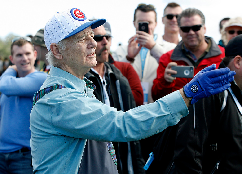 . Bill Murray motions for the gallery to move prior to hitting his thrid shot on the 6th hole at the Pebble Beach Golf Links during the third round of the AT&T Pebble Beach Pro Am on Saturday, Feb. 11, 2017.   (Vern Fisher - Monterey Herald)