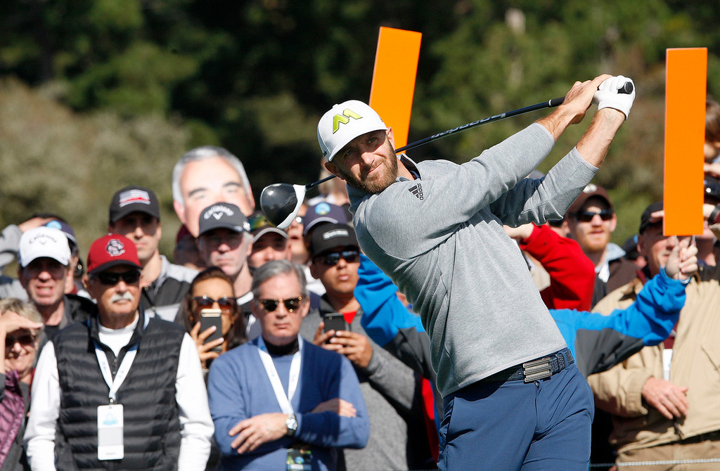 . Dustin Johnson watches his tee shot from the 6th hole at the Pebble Beach Golf Links during the third round of the AT&T Pebble Beach Pro Am on Saturday, Feb. 11, 2017.   (Vern Fisher - Monterey Herald)